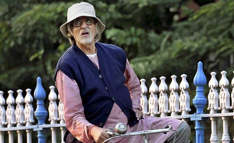Piku Movie Review- Amitabh Bachchan on cycle